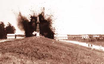 Dynamiting the Mississippi River levee in St. Bernard Parish, 1927 (Corps of Engineers photo)