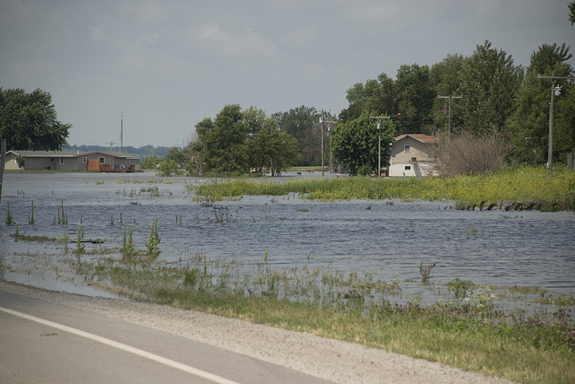 Holt County Levee District No. 10, a non-federal levee near Rulo, Neb., experienced an overtopping breach June 18, 2011, flooding U.S. Route 159 and the surrounding area. Photo by Diana Fredlund, US Army Corps of Engineers. Image from Flickr.