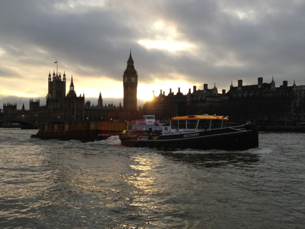 Boats on the river at sunset with Parliament in the background