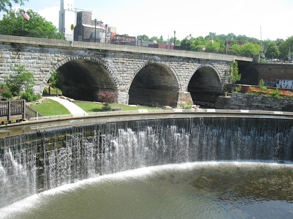 dam, arched bridge, small town bucolic scene