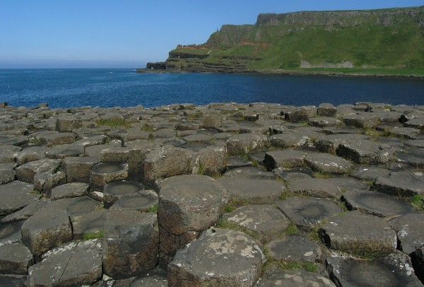 Giant's Causeway in the foreground, cliffs of more lava punctuated by a red laterite horizon beyond.  Photo: Chris Rowan, 2013