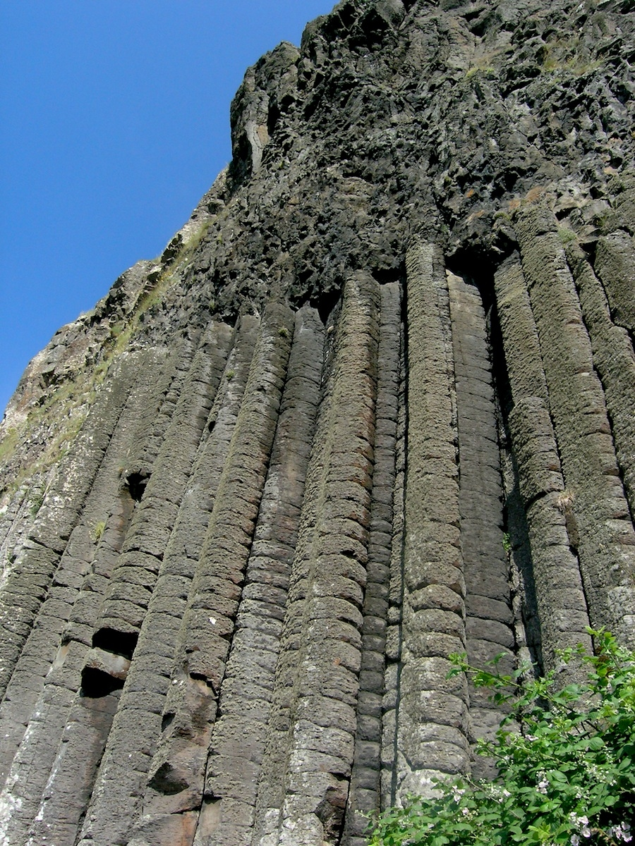 A close-up of 'The Organ', showing how the regular columnar jointing vanishes in the fast-cooling top of a lava flow.  Photo: Chris Rowan, 2013