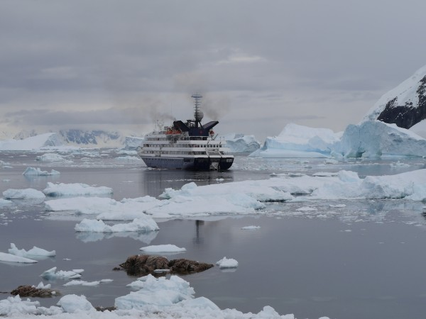 Vessel amidst sea ice, Neko Harbour