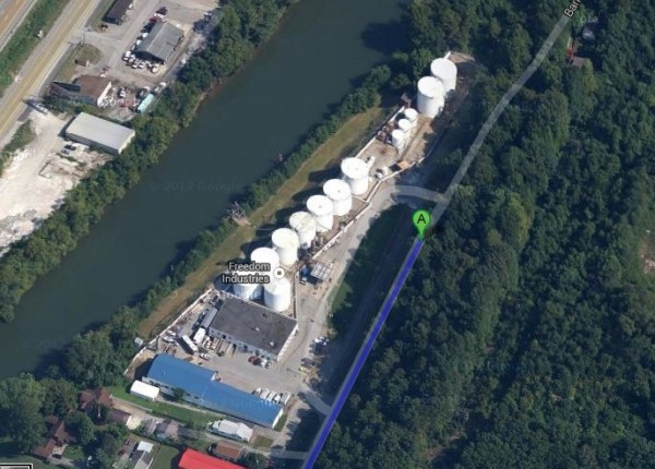 Google Maps view of white industrial tanks adjacent to a river.