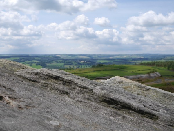 Looking past some cross-beds in the Millstone Grit, over Bichen Edge.