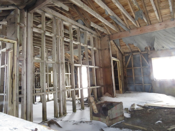 A peak inside one of the many abandoned buildings at Whaler's Bay. Photo by A. Jefferson.
