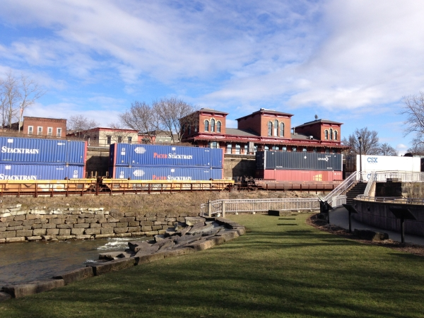 Rivers have long been transportation corridors. Historic Kent depot behind the modern freight train running next to the river, with its remnant lock system. (Photo by A. Jefferson, March 2015).