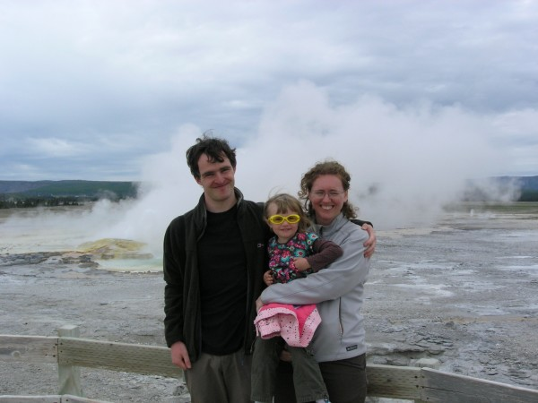 Allochthonous family looking the wrong way as a geyser does its thing