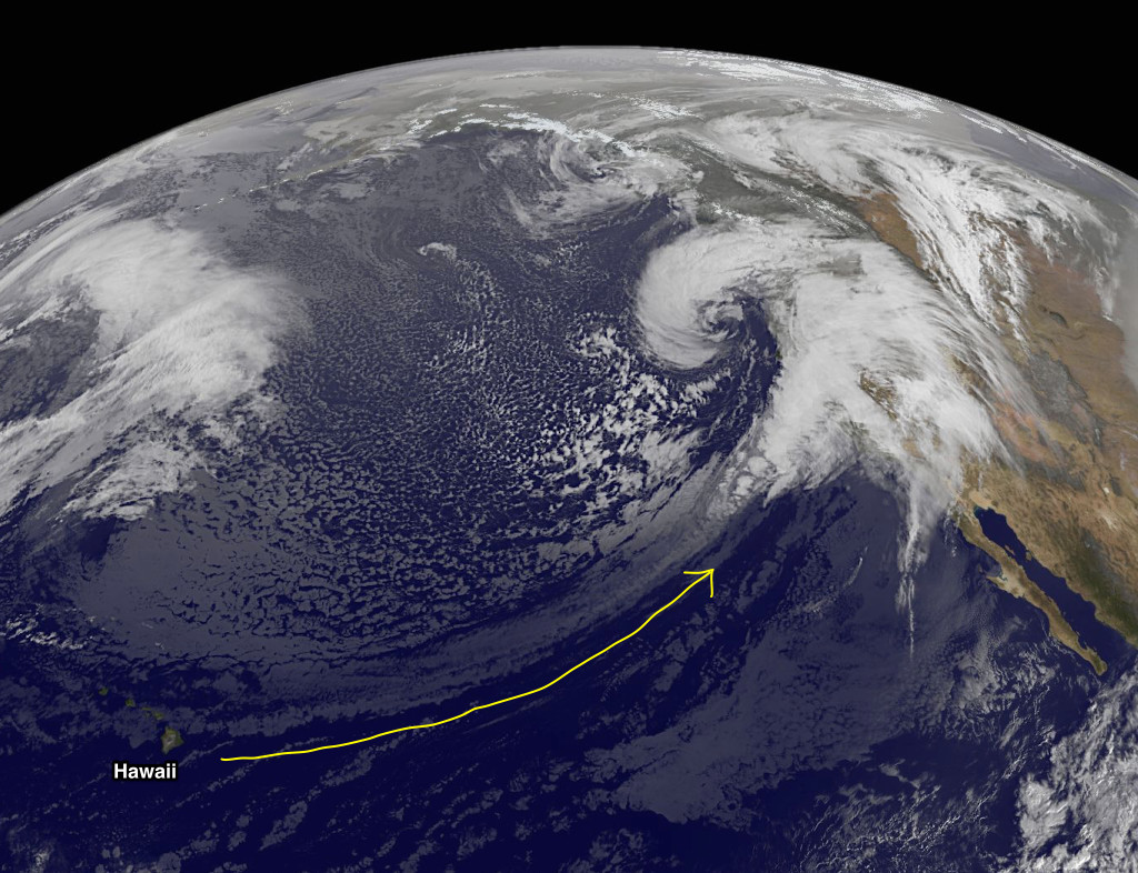 Satellite image showing narrow band of clouds stretching from Hawaii to California