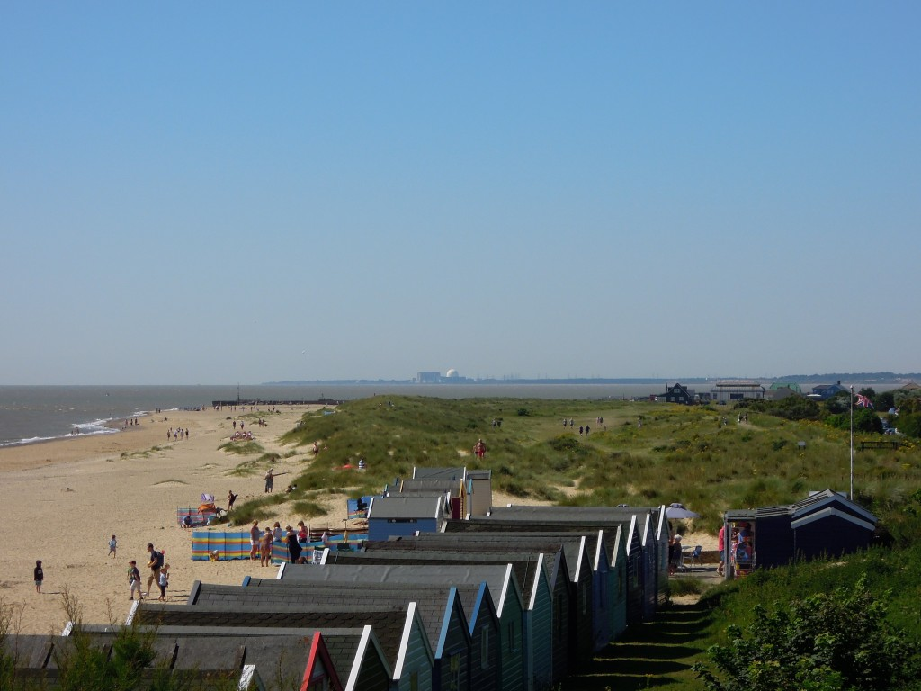 Looking south from Southwold. Sizewell nuclear power station on horizon. Bay in the middle used to contain Dunwich