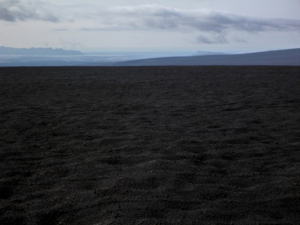 A black sandy desert