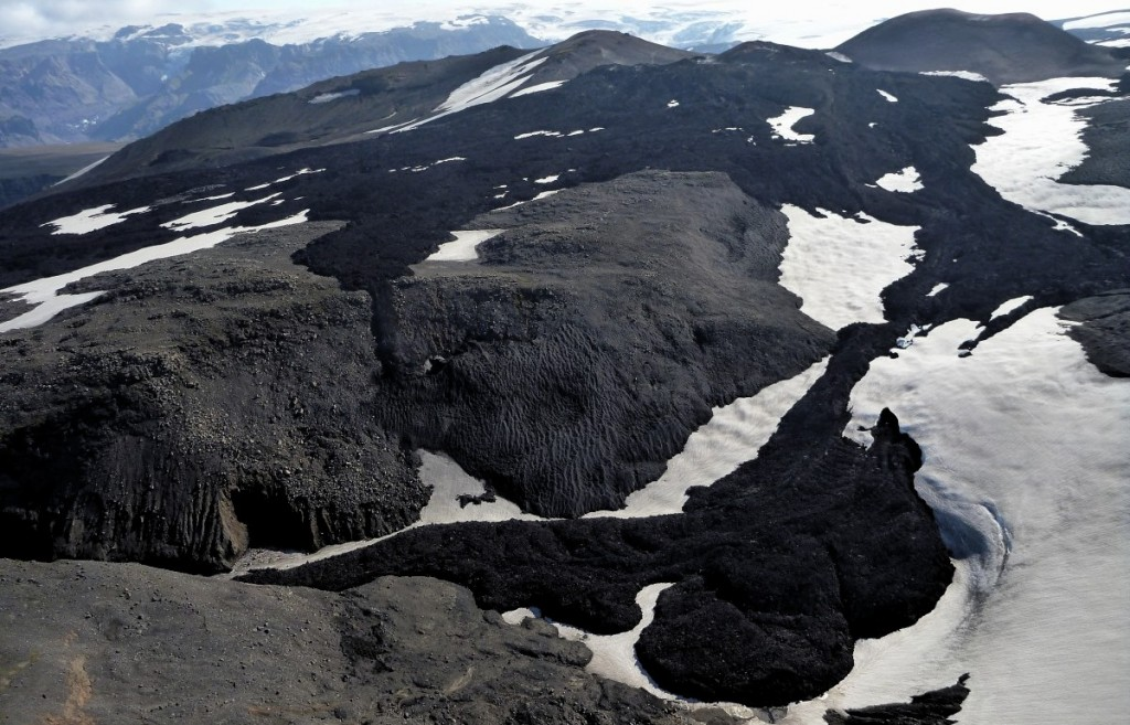 The Fímmvörðuháls lava is a small basaltic flow that was erupted on the  eastern flank of Eyjafjallajökull volcano from 20 March to 12 April 2014.  Two days after this eruption ended, activity switched to the ice-covered crater at the volcano's summit and began producing the notorious ash cloud.